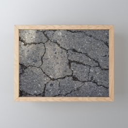 Cracked road background texture. Framed Mini Art Print
