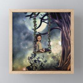 Cute little fairy with kitten on a swing Framed Mini Art Print