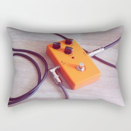 orange pedal effect and black cables on wooden floor. toning Rectangular Pillow