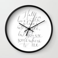 the cure Wall Clocks featuring Wanderlust Cure by Tiff Hung