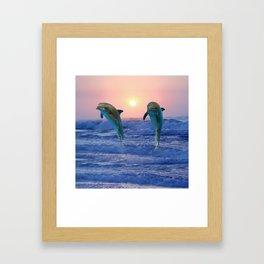 Dolphins at sunrise Framed Art Print