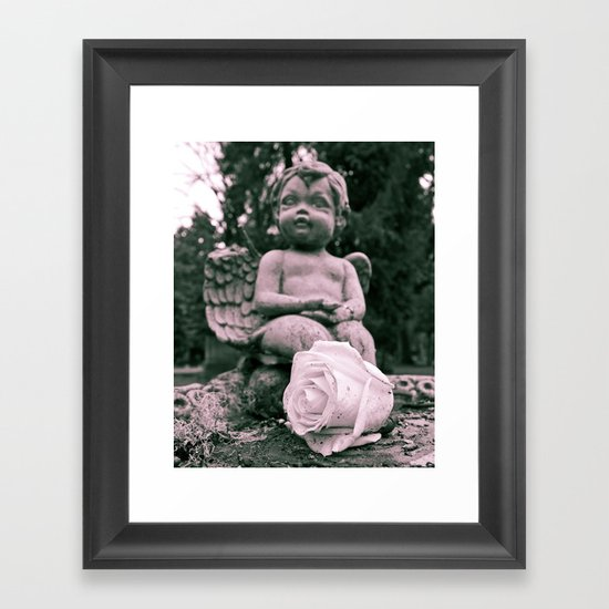 Cherub and rose Framed Art Print