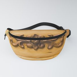 Wooden decor on an old cabinet Fanny Pack