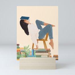 Lost in my books Mini Art Print