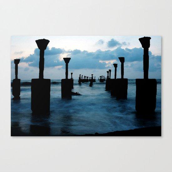 Pillars by the sea Canvas Print
