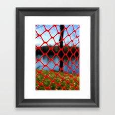 Red fencing Framed Art Print