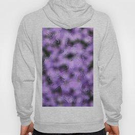 flowers behind wet glass 1 Hoody