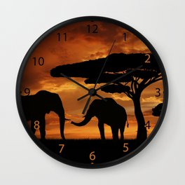 African elephants silhouettes in sunset Wall Clock