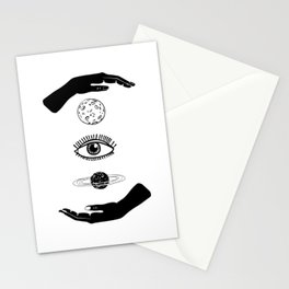 Two hands, between them the moon, eye and planet. Black and white. Stationery Cards