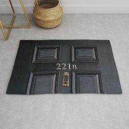 Haunted black door with 221b number Rug
