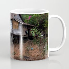 Picturesque Stilt house on the Mekong River Bank, Laos Coffee Mug