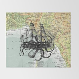 Octopus Attacks Ship on map background Throw Blanket