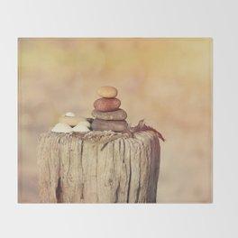Balanced stone cairn in sunset light Throw Blanket