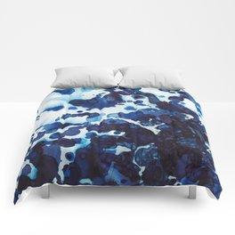Big ocean waves crashing on the rocks. Comforters