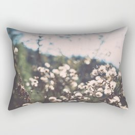 Faded white flowers on the side of a mountain Rectangular Pillow