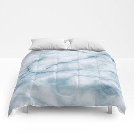 Light blue marble texture Comforters