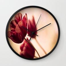 blown in the wind Wall Clock