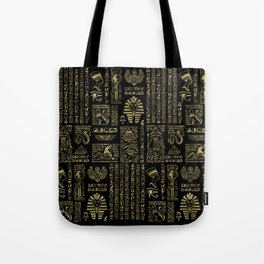 Egyptian hieroglyphs and deities gold on black Tote Bag