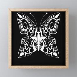 Openwork white butterfly on black background Framed Mini Art Print