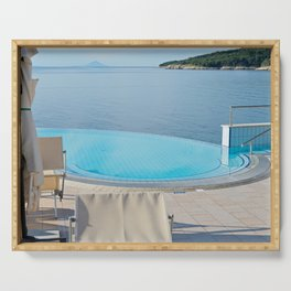 Empty infinity pool on the sunrise, quiet bue sea Serving Tray