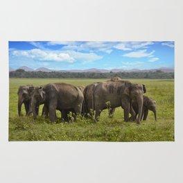 group of elephants Rug