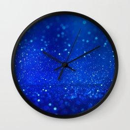 Abstract blue bokeh light background Wall Clock