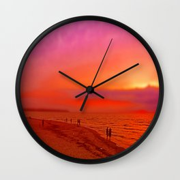 Sunset in orange and pink by the beach Wall Clock