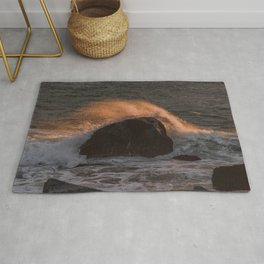 Golden Wave crashing on a rock Rug