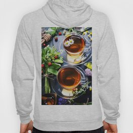 Herbal tea with honey, wild berry and flowers on wooden background Hoody