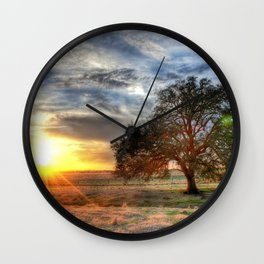 Lonely tree in a field Wall Clock