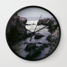 Dark and Rocky Coastline Wall Clock