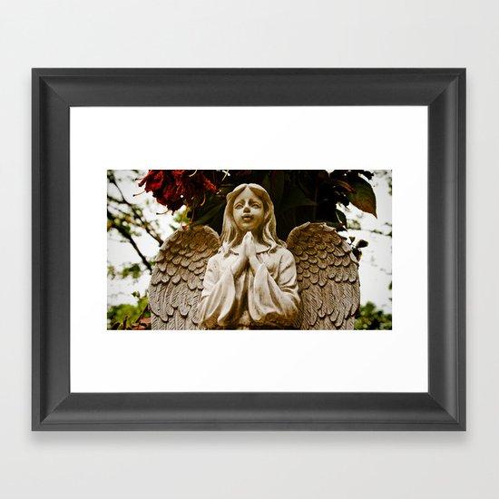 The angel prays Framed Art Print