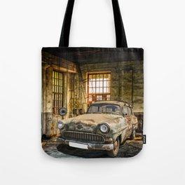 Old Car in a Garage Tote Bag