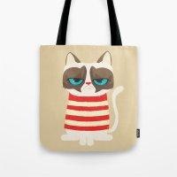 meme Tote Bags featuring Grumpy meme cat  by UiNi