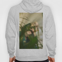 Blurred woman and man behind plants, dancers, romance Hoody