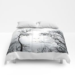 face in the trees Comforters