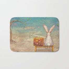 Sad rabbit  with suitcase sitting on the bench on the cloud in sky  Badematte