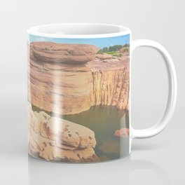 Scenic red brown rock forming into small peninsula Coffee Mug