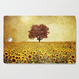lone tree & sunflowers field Cutting Board
