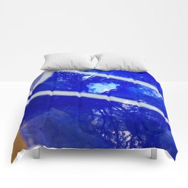 Tree reflection in blue glass Comforters