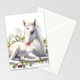 Baby unicorn lies in flowers Stationery Cards