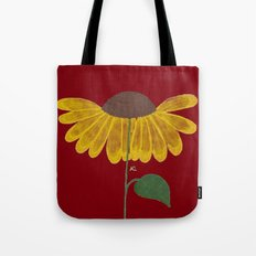 Yellow flower on a burgundy background Tote Bag