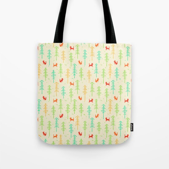 Foxes hiding in the forest Tote Bag