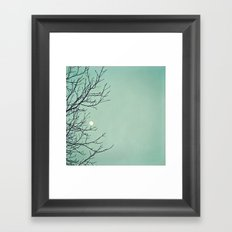 Holding the moon Framed Art Print