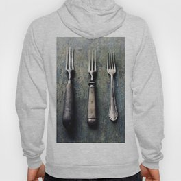 Vintage forks on rustic wooden background Hoody