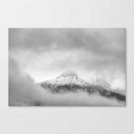 Peak in the clouds Canvas Print