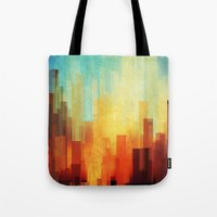 manhattan Tote Bags featuring Urban sunset by SensualPatterns