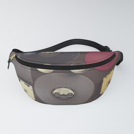 Music. Vintage wall with vinyl records and audio cassettes hung. Fanny Pack