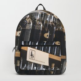 Homemade liquors in a store Backpack