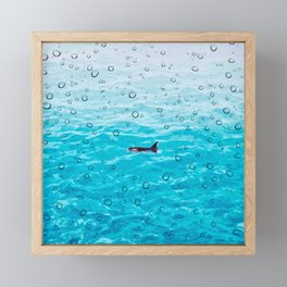 Orca Whale gliding through the water on a rainy day Framed Mini Art Print
